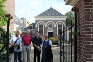 "Here at what used to be a ""hidden meetinghouse"" the Alkmaar Anabaptist congregation, led by Hans de Ries, already met in the 1500s. Jaap Kroon, Kees Kipenberg, Justin and Susan (Krahn) Hoover at Alkmaar in 2013."